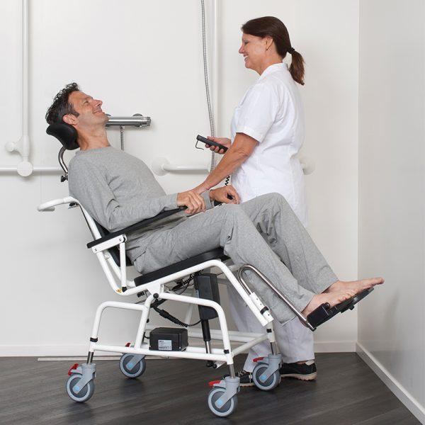 combi commode shower chair tilting in use handicare 2