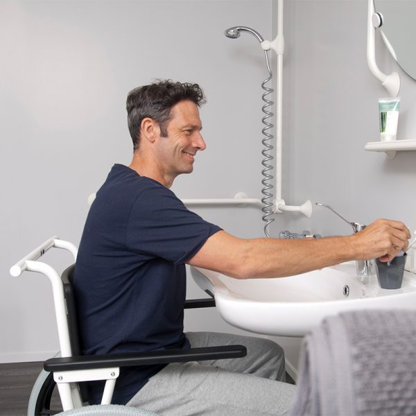 combi commode shower chair user operated in use handicare 2