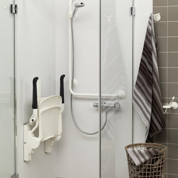 ergonomic shower seat white folded up handicare 2