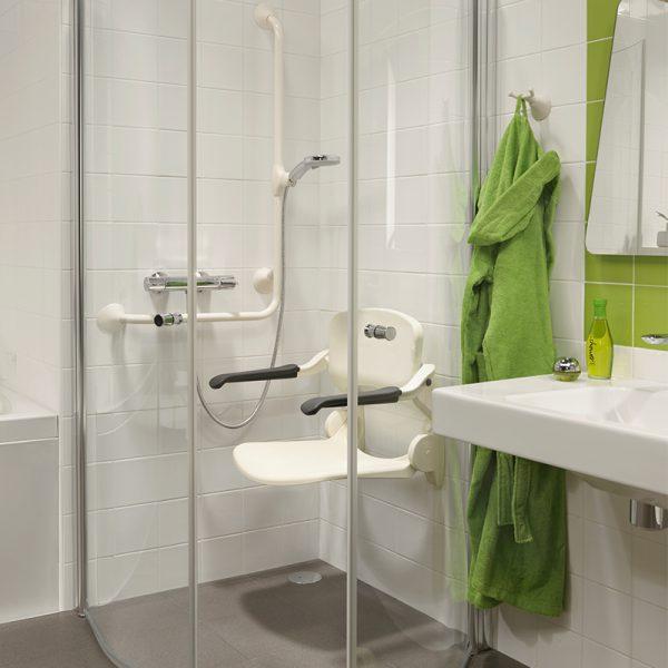 ergonomic shower seat white in use handicare 2