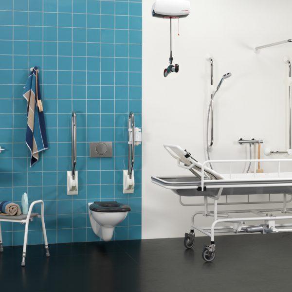 height adjustable shower trolley in use bathroom handicare 1