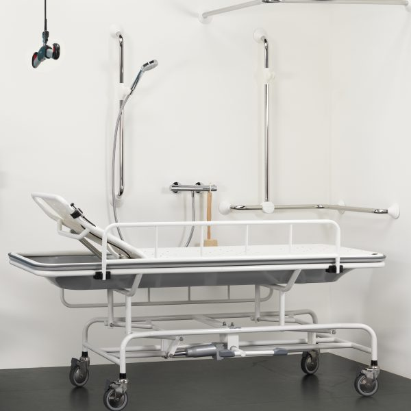 height adjustable shower trolley side view handicare 1