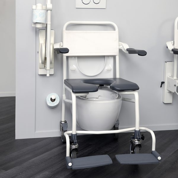 mobile commode shower chair user operated in use handicare