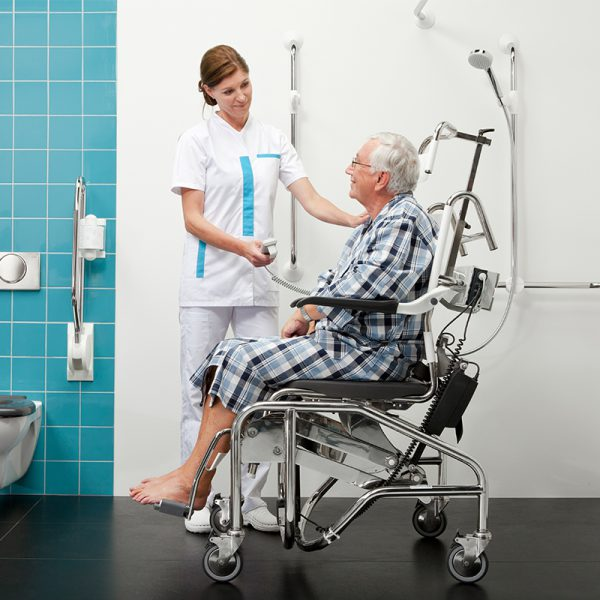 tilting commode shower chair in use with nurse handicare