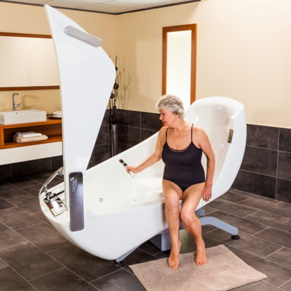 beka averno motion bath tub open door with patient seated 4 600x600