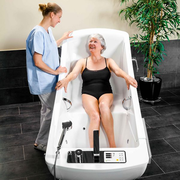 beka averno motion bath tub with patient and caregiver 4 600x600
