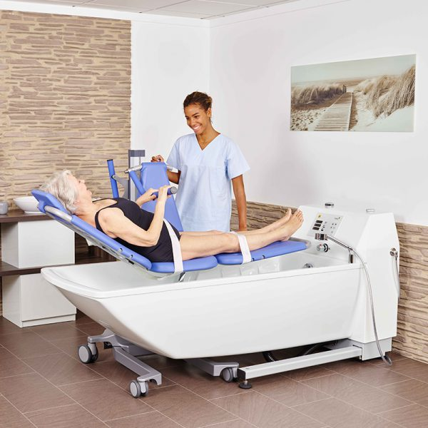beka averno premium plus bath tub with patient and caregiver and senta pur l bath and shower lift extended 2 600x600