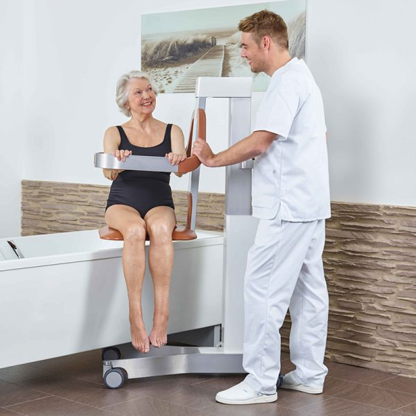 beka eve bath and shower lift patient with caregiver 600x600